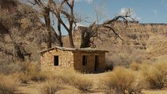 Rock House Pioneer Outlaw Cabin in the Wild American West - stock footage