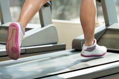 Exercising on a treadmill Stock Photos