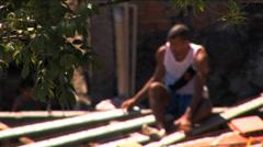 Male worker favela Urban housing Rio de Janeiro Brazil South America - stock footage