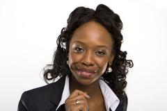 solated studio shot of a smiling businesswoman - stock photo