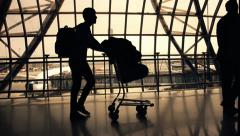 silhouettes of travellers in airport - stock footage