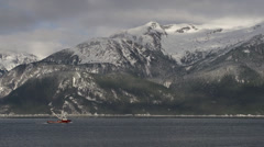 Alaskan Fishing Vessel Leaving Haines on Sunny Winters Day - long Stock Footage