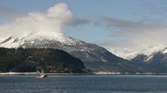 Alaskan Fishing Vessel Leaving Haines on Sunny Winters Day - medium. Stock Footage