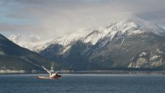 Alaskan Fishing Vessel Leaving Haines on Sunny Winters Day - stock footage