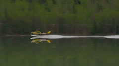 Alaskan Floatplane Taking off from Calm Lake on Cloudy Days in Mount Stock Footage