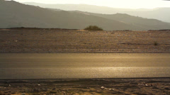 Car traveling through the desert,car road through the desert Stock Footage
