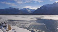 Alaskan Scenic Snowy Chilkat River and Mountains on Sunny Winters Da Stock Footage