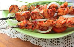 Grilled chicken bbq on a skewer Stock Photos