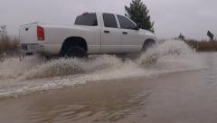 Big White Pickup Passing through Water on Flooded Country Road Stock Footage