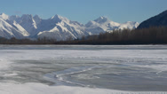 Stock Video Footage of Blowing Snow Slithering Across Frozen Surface of Scenic Chilkat Rive