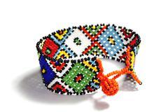 isolated single traditional bright beadwork zulu bracelet - stock photo