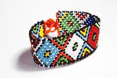 isolated traditional bright beaded zulu bracelet - stock photo