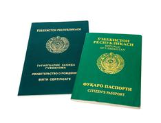Uzbekistan passport and birth certificate isolated on the white background Stock Photos