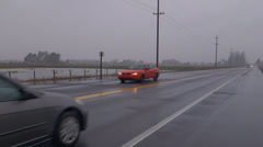 Cars on Highway through Flooded Farmland Stock Footage