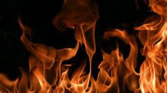 Closeup of flames burning on black background, slow motion - stock footage