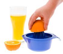 Preparation of orange juice Stock Photos