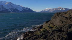 Chilkat Inlet on Rocky Shore Windy Waves Sunny Winter Day Stock Footage