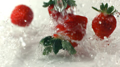 Strawberries falling and splashing, slow motion Stock Footage