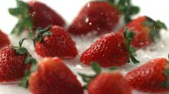 Water splashing on fresh strawberries, slow motion - stock footage