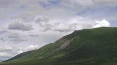 Stock Video Footage of Cloudshadows Moving Across Craggy Yukon Mountain Tor
