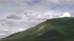 Cloudshadows Moving Quickly Across Craggy Yukon Mountain Tor Stock Footage