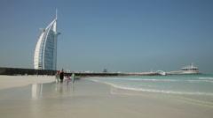 DUBAI, UNITED ARAB EMIRATES - Mother and children walk - stock footage