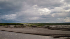 Copper River Vast Tundra Stormy Rainclouds and Rainbow Pan Left Stock Footage