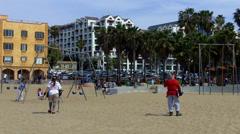 People Using Metal Detectors On Santa Monica California Beach Stock Footage