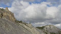 Craggy Crumbling Rock Formation Northern Yukon Zoom Out Big Clouds Stock Footage