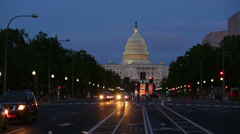 United States Capitol building at night from from Pennsylvania Avenue with cars - stock footage