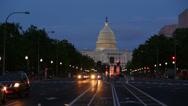 Stock Video Footage of United States Capitol building at night from from Pennsylvania Avenue with cars