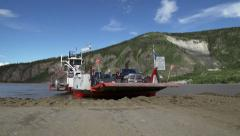 Dawson City Yukon River Ferry Landing close low angle stabilized Stock Footage
