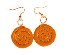 yellow-brown earrings with sequins. spiral - stock photo