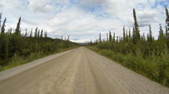 Driving POV Boreal Forest North Yukon Dempster Highway Gravel Road Stock Footage
