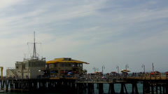 West End Of Santa Monica California Ocean Pier With People Stock Footage