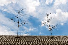 Tv antennas on the roof Stock Photos