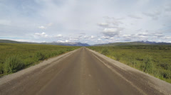 Driving POV North on Dirt Road to Inuvik Yukon Territory Canada Demp Stock Footage