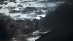 Evil Dark Storm Clouds Obscure Sun Orb over Mountain of Doom - stock footage