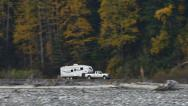 Stock Video Footage of Fifth Wheel Trailer Motorhome and Truck Fall Colors Birches Drive By