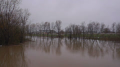 Floodwaters Encroaching on Rural Farmstead Danger Stock Footage
