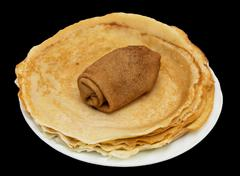 russian pancakes on a black background - stock photo