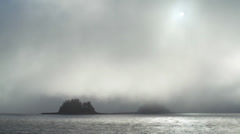 Foggy Southeast Alaska Passing Islands Hazy Sun in Mist Stock Footage