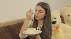 Girl eats cake and enjoy it Stock Footage