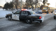 Stock Video Footage of Police Car in Winter at Roadblock