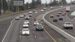 Freeway Traffic Rounding the Bend Cloudy Day Stock Footage