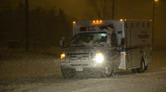 Ambulance Leaving Crash with Heavy Snow At Night Stock Footage