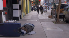 Homeless Man Sleeping on Sidewalk SF Passers-By Oncoming Stock Footage