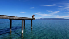Photographer on a Peer at Lake Tahoe Stock Footage