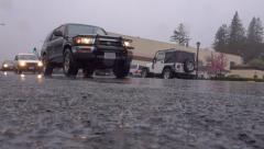 Low Angle City Traffic in Rain Sebastopol California Stock Footage