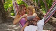 Stock Video Footage of Mother and son in hammock using digital tablet, Costa Rica